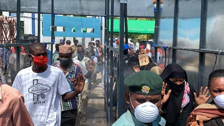 Mombasa Likoni ferry disinfectant facility sprays twelve people at time, disinfecting the whole body as you pass through to board the ferry.