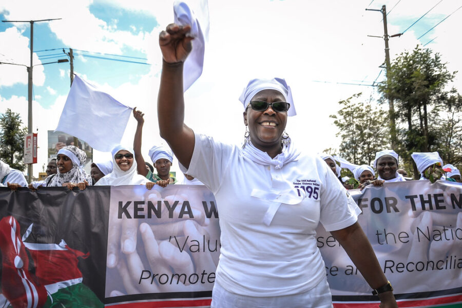 Ahead of Kenya's 2017 elections, the White Ribbon Campaign march to promote their rapid response hotline which responds to violence against women in elections. Credit: Carla Chianese, IFES.